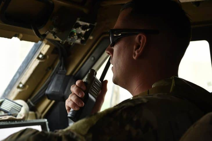 Security Forces Squadron truck commander uses handheld aviation radio