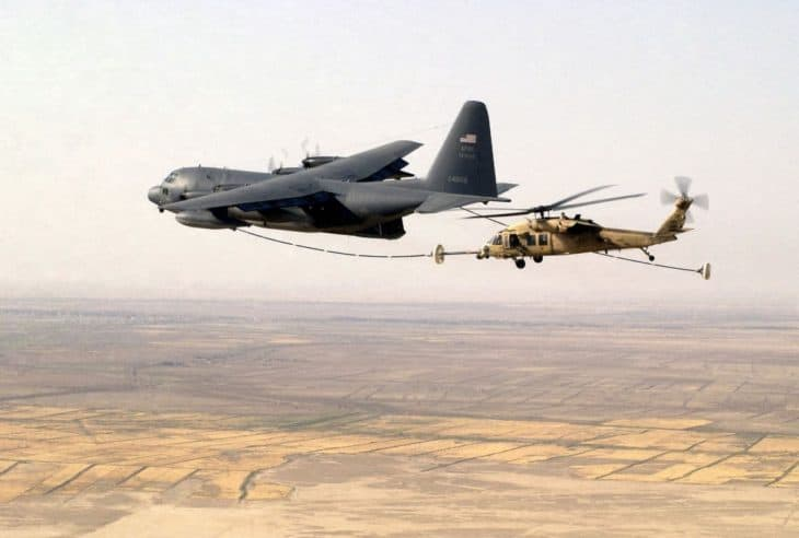 US Air Force Reserve HH-60G Pave Hawk refueled by HC-130 Hercules over Tallil Air Base Iraq