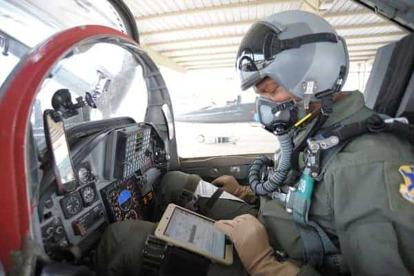 military pilot using ipad in cockpit