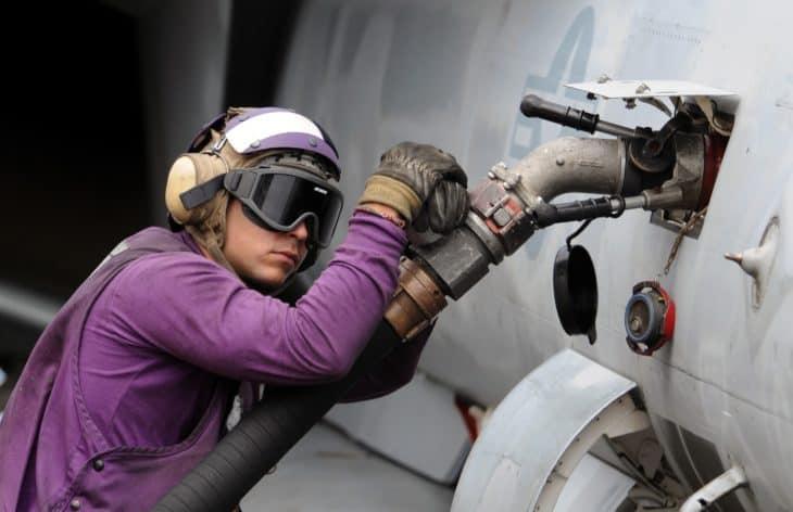 US Navy Airman fueling an F18 Hornet