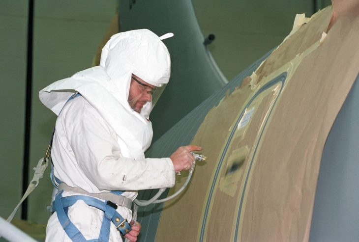 painting stenciling on a KC-135 Stratotanker emergency exit door