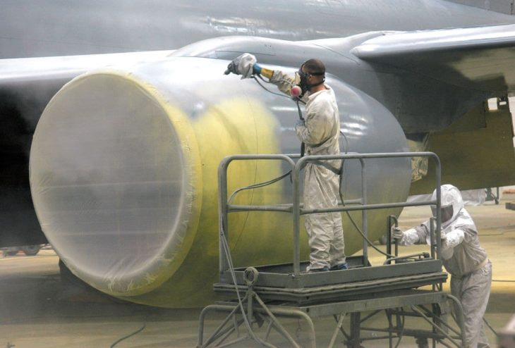 spray painting the first coat on a KC-135 Stratotanker engine cowling
