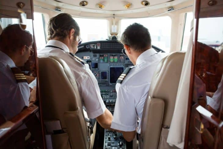 Pilot and copilot in cockpit of corporate jet