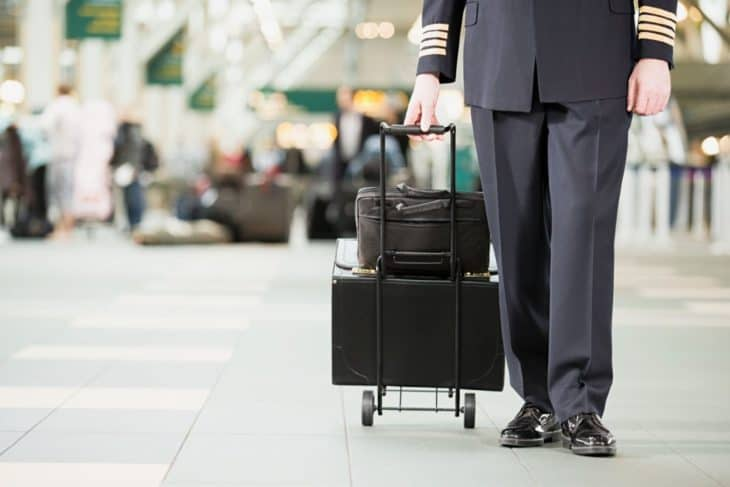 pilot with bags at airport
