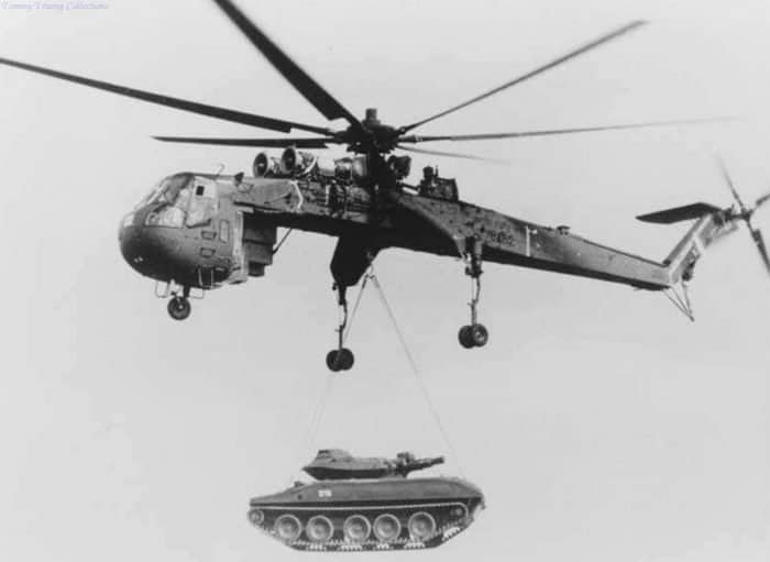 US Army heavy lift helicopter (CH-54) lifting a tank during the Vietnam war, mid 1960s