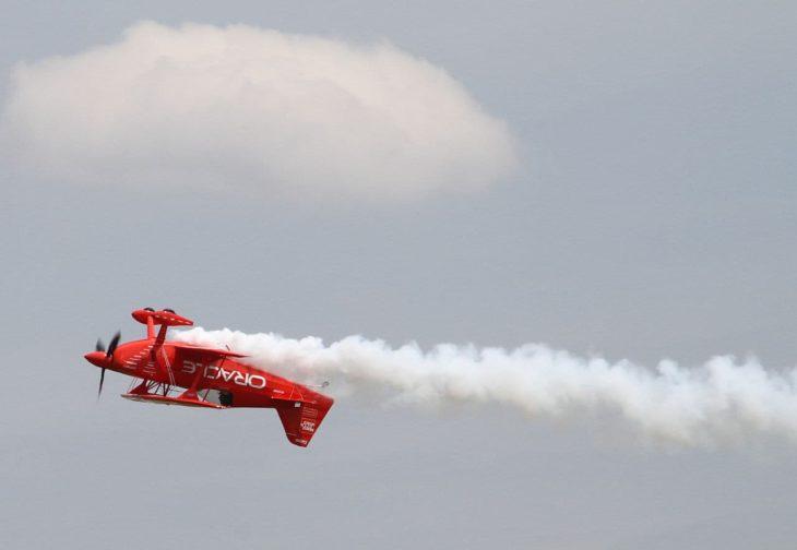 Aerobatic stunt plane flying upside down