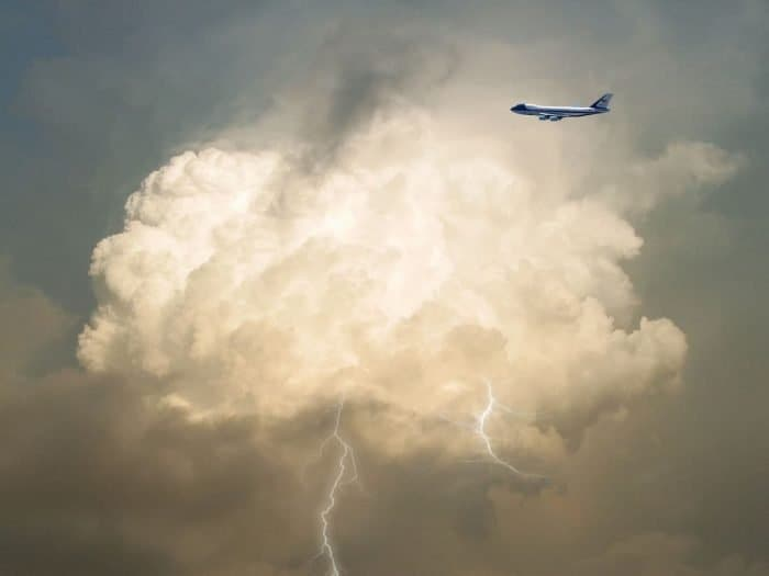 Airplane flying through storm