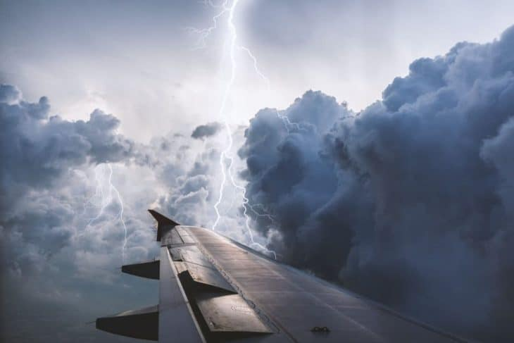 Airplane wing view thunderstorm