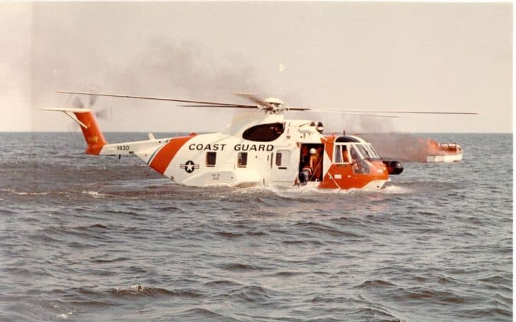 An HH-3F Pelican helicopter of the United States Coast Guard lands on the water