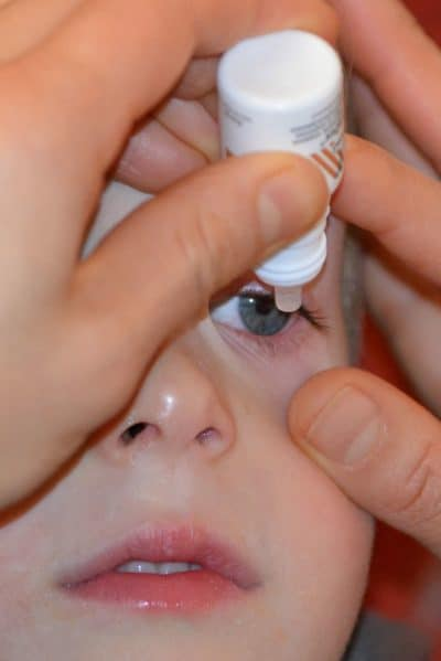 Applying eye drops
