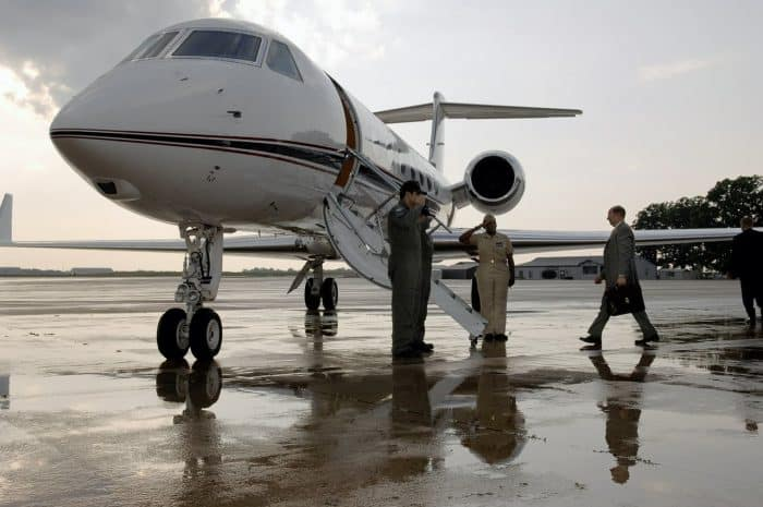 Business man boarding a private jet
