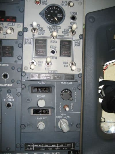Cabin Pressure and Bleed Air Control Panels on a Boeing 737-800