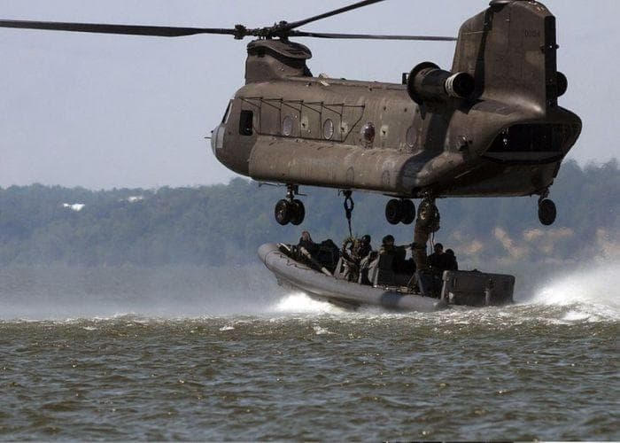 Chinook assisting troops in dinghy