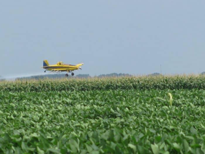 Crop Duster Spraying Corn