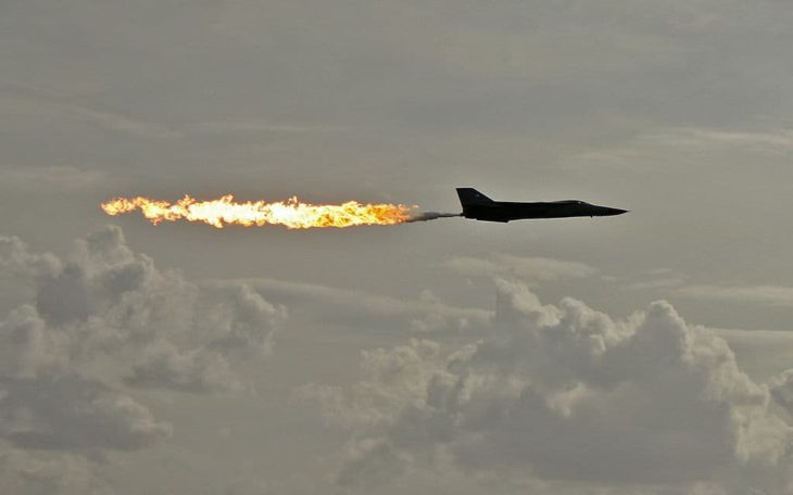 General Dynamics F-111 Aardvark aircraft performing a dump-and-burn fuel dump