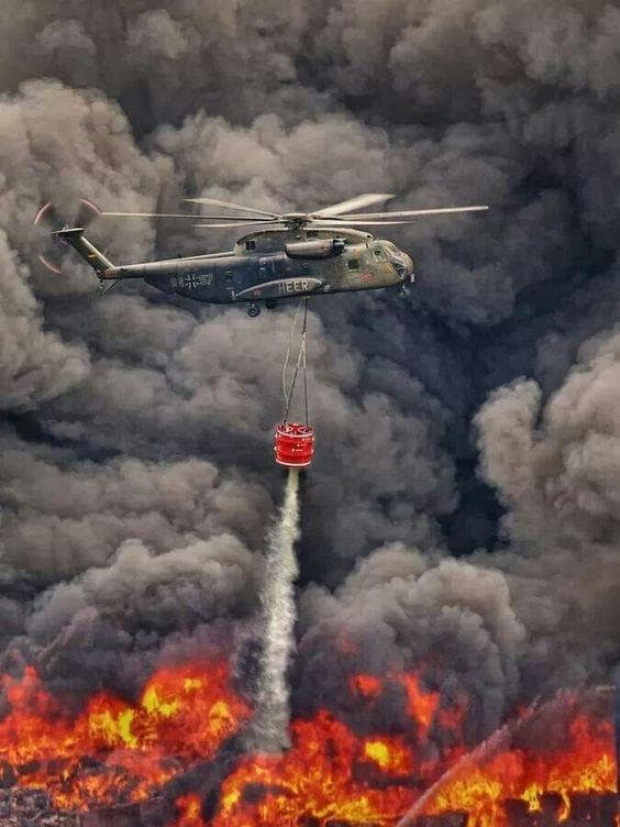 Helicopter Fighting Forest Fires