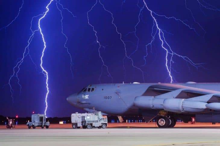 Lightning strikes behind a Boeing B-52H Stratofortress at Minot Air Force Base, N.D., Aug. 8, 2017