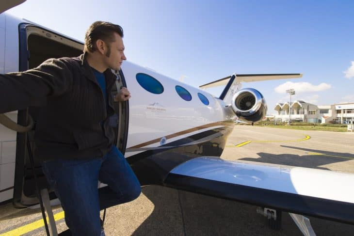 Man exiting private jet