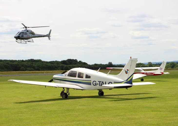 News helicopter lands at grass airfield