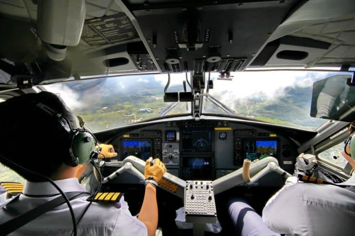 Pilots in cockpit of DHC-6 Twin Otter