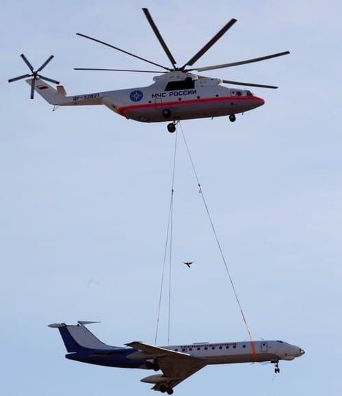 Russian MIL Mi-26 airlifting a plane