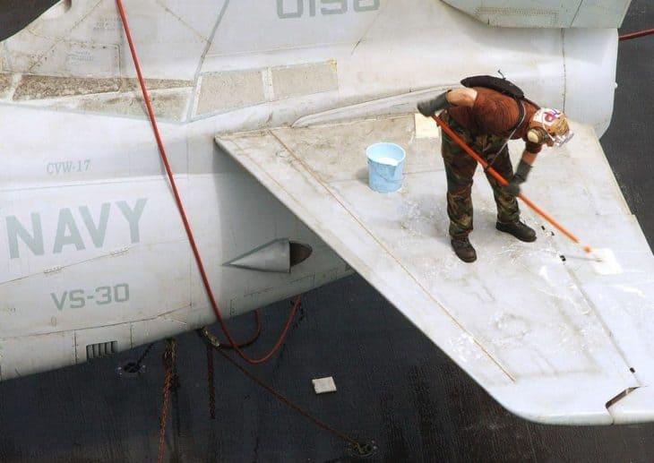 Scrubbing an S-3B Viking horizontal stabilizer