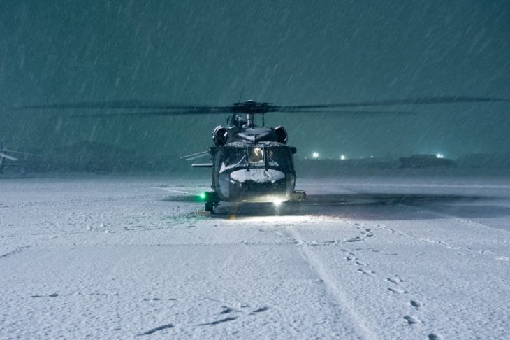 U.S. Army UH-60 Black Hawk helicopter conducts an engine run-up in a winter storm at Bagram Airfield in Afghanistan
