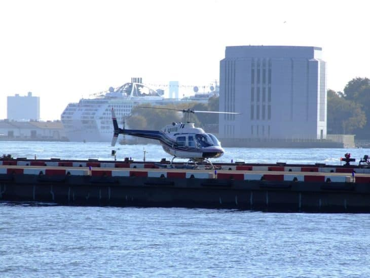 helicopter sits on the helipad at Manhattan Heliport, Lower Manhattan, New York City