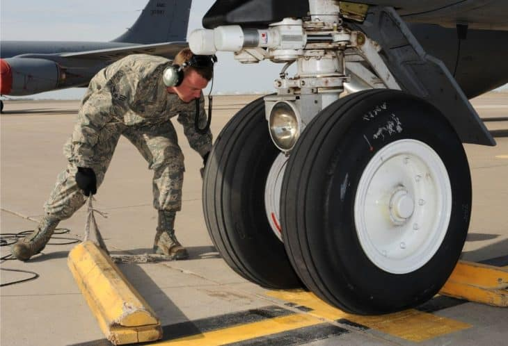 Chocks Away! - removing the chocks from around the front wheels of a KC-135 Stratotanker
