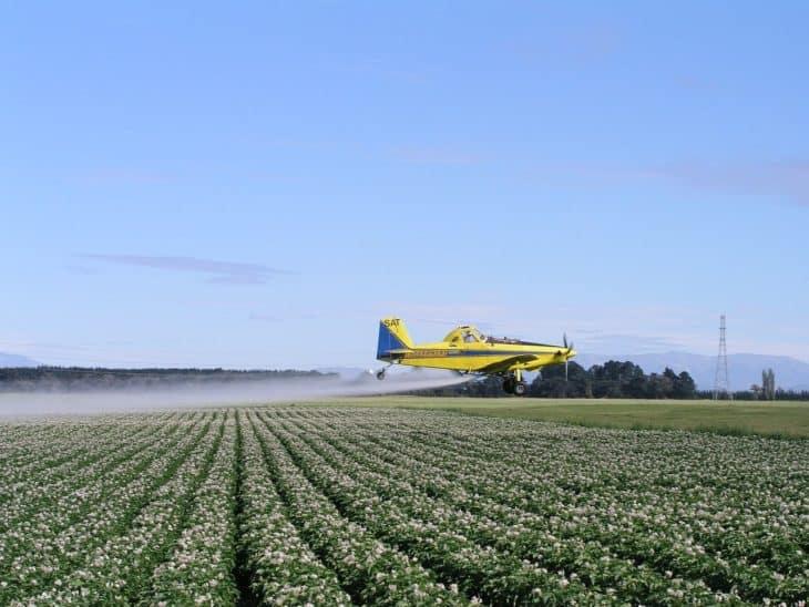 Crop duster spraying