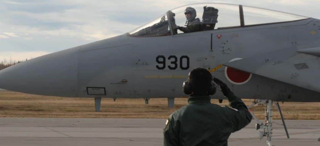 Japan Air Self Defense Force maintenance officer saultes F 15 Eagle pilot