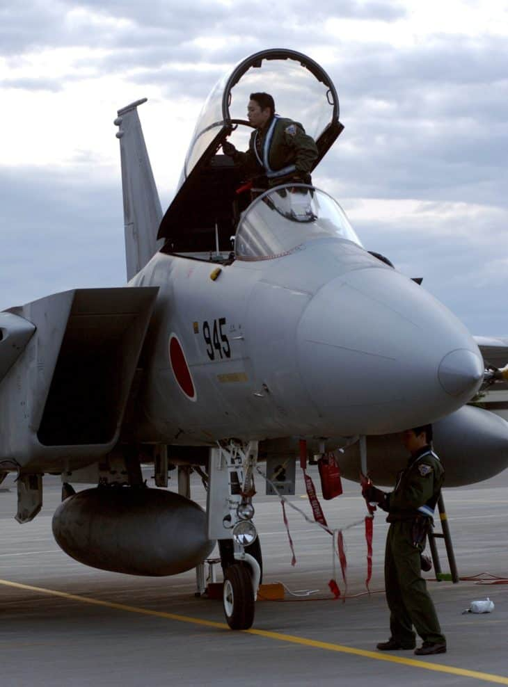 Japanese Air Self Defense Force maintainers work on a F 15J fighter
