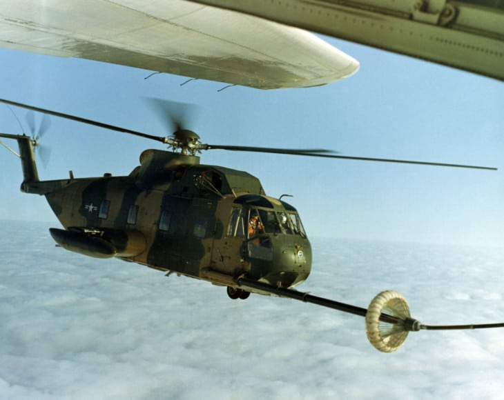 An Sikorsky HH 3ES 61R Jolly Green Giant being refueled by an Lockheed HC 130
