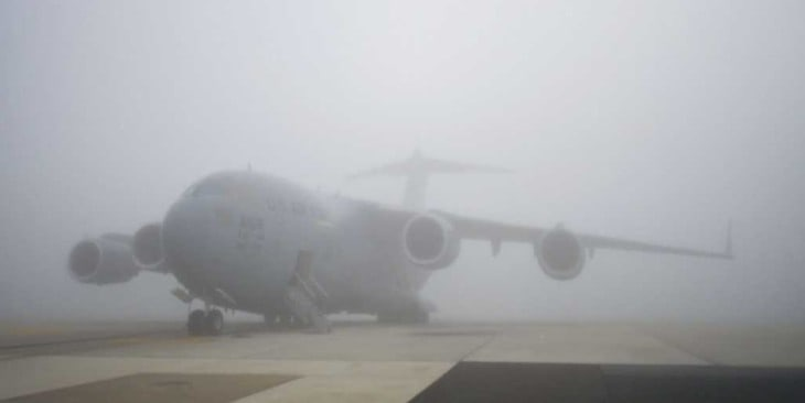 C 17 Globemaster III aircraft sits on the foggy runway