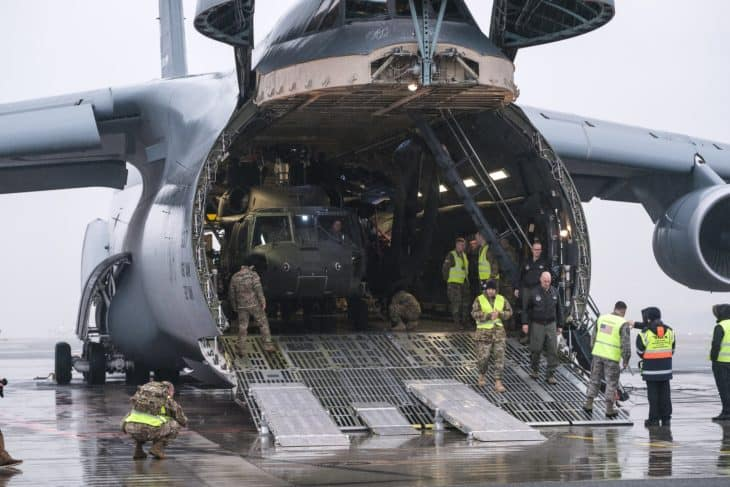 Lockheed C 5M Super Galaxy unloading Sikorsky Blackhawks to Riga airport