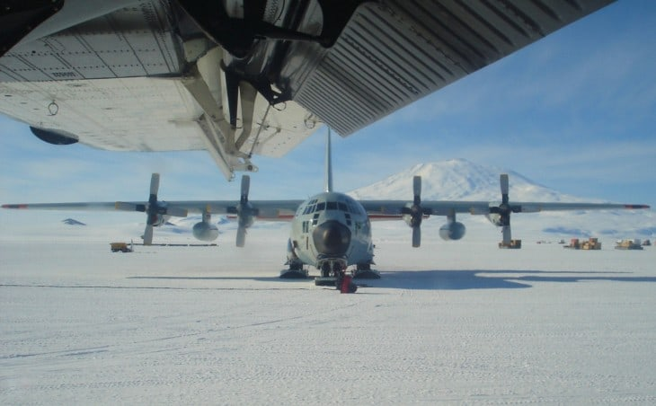 United States Air Force Lockheed LC 130 Hercules at Williams Field. Mt. Erebus in the background