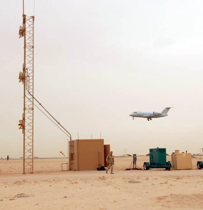 A modified CL 60 Challenger aircraft flies a low level approach past an instrument landing system being used in 2007 in Southwest Asia