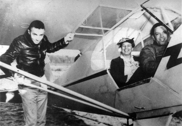 Eleanor Roosevelt rides with pilot Charles Alfred Anderson a Tuskegee Airmen