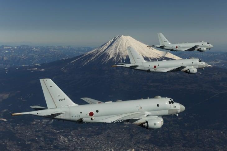 3 JMSDF Kawasaki P 1 in flight with Mount Fuji in the background