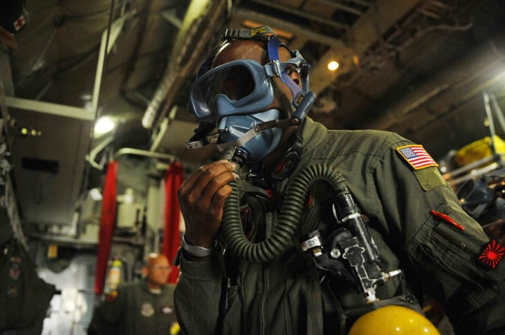 USAF Officer wearing a quick don oxygen mask