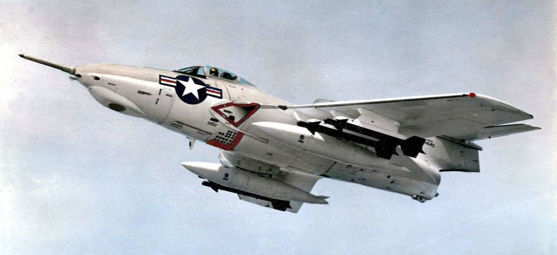 A U.S. Navy Grumman F9F 8 Cougar armed with AIM 9B Sindewinder air to air missiles in 1958.