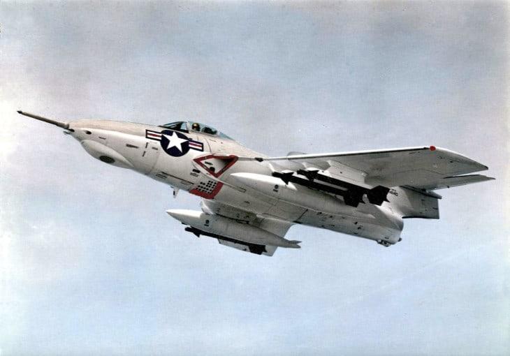 A U.S. Navy Grumman F9F 8 Cougar armed with AIM 9B Sindewinder air to air missiles in 1958.