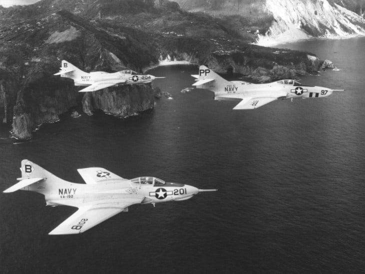 Two U.S. Navy Grumman F9F 8B Cougar of Attack Squadron VA 192 Golden Dragons and an F9F 8P of Photographic Reconnaissance Squadron VFP 61