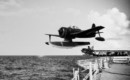 A U.S. Navy Curtiss SC 1 Seahawk is catapulted off the battleship USS Iowa.
