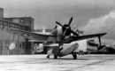 A U.S. Navy Curtiss SC 1 Seahawk sea plane on the sea wall at Naval Air Station Jacksonville Florida. 1946