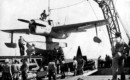 A U.S. Navy Curtiss SO3C Seamew on a catapult of the light cruiser USS Columbia .