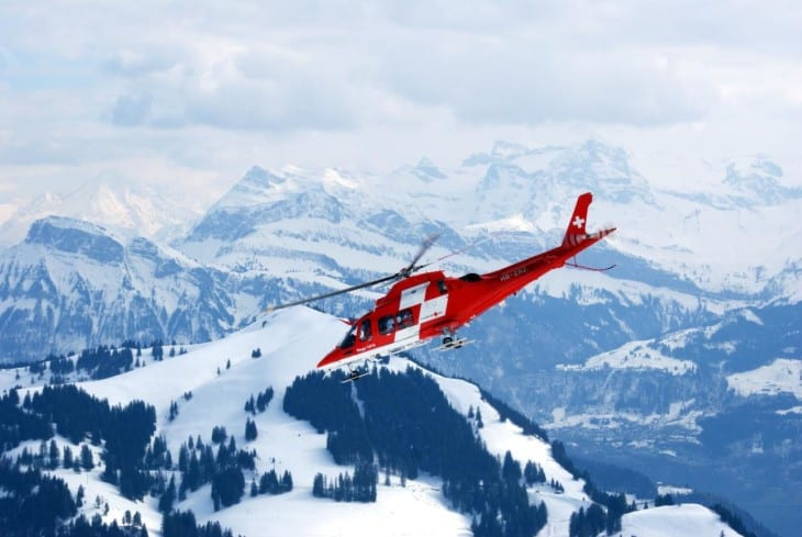Helicopter over snowy mountain range