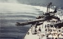 The U.S. Navy light cruiser USS Biloxi turns into the wind to catapult a Curtiss SO3C Seamew.
