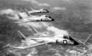 Three Vought F7U 3 Cutlass in flight.