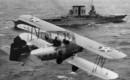 Vought O2U 2 Corsairs of VS 14M fly over USS Saratoga.